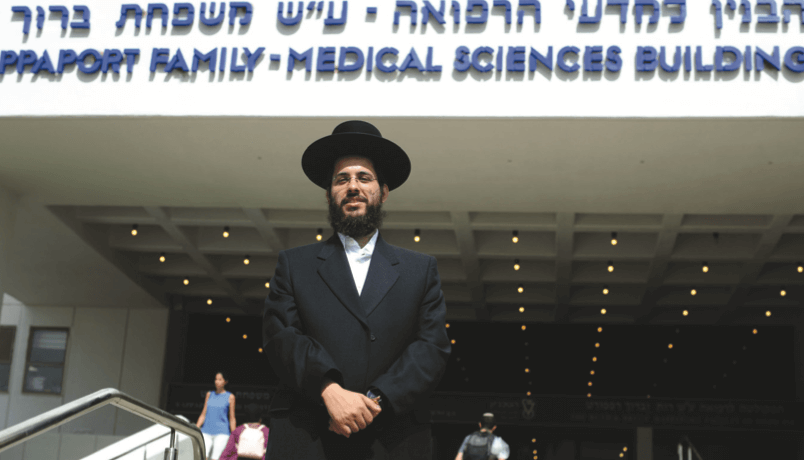Sabiner poses for a photograph outside the of Rapaport Family Medical Sciences Building (RAMI SHLUSH / TECHNION)