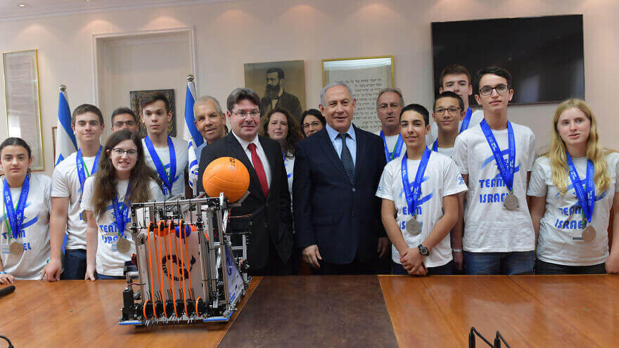 Israeli Prime Minister Benjamin Netanyahu and Israeli Science and Technology Minister Ofir Akunis host the Israeli robotics team that participated in the First Global Challenge robotics olympiad in Dubai, Nov. 6, 2019. Credit: Kobi Gideon/GPO.