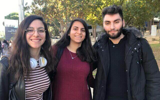 Luna Karayanni, a 20-year-old second-year computer sciences student at the Technion, left, together with Mais Haddad, her 20-year old friend, who studies bio-medical engineering, and Sabri Asssaf, a 20-year-old bioengineering student, at the Technion campus in Haifa' December 19, 2019. (Shoshanna Solomon/Times of Israel)