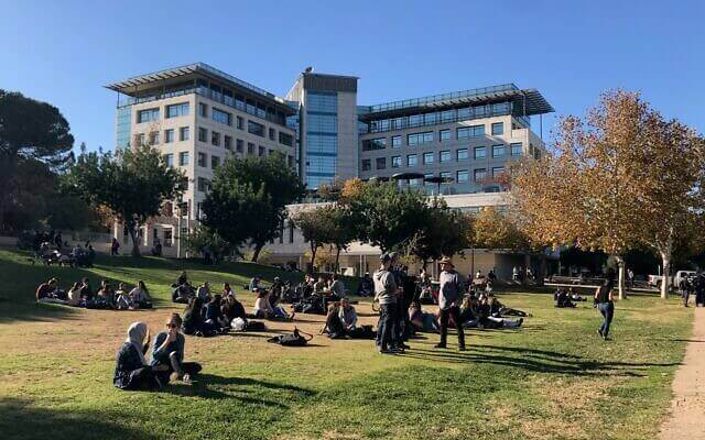 Technion students taking a break on the grass on a sunny winter day when entrepreneurs flocked to the Haifa campus to talk to students, December 19, 2019. (Shoshanna Solomon/Times of Israel)