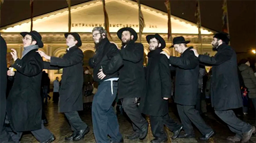 Jewish men celebrate Hanukkah at Manezhnaya square in the center of Moscow December 4, 2007 Credits: Reuters