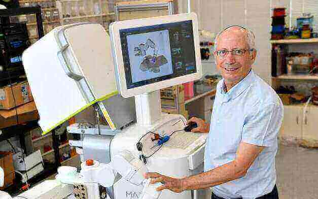 Prof. Moshe Shoham with the Mazor Robotics system, which was sold to Medtronic for $1.64 billion (Courtesy)